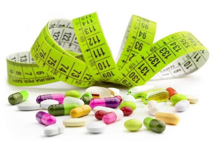 Сантиметр и таблетки с капсулами