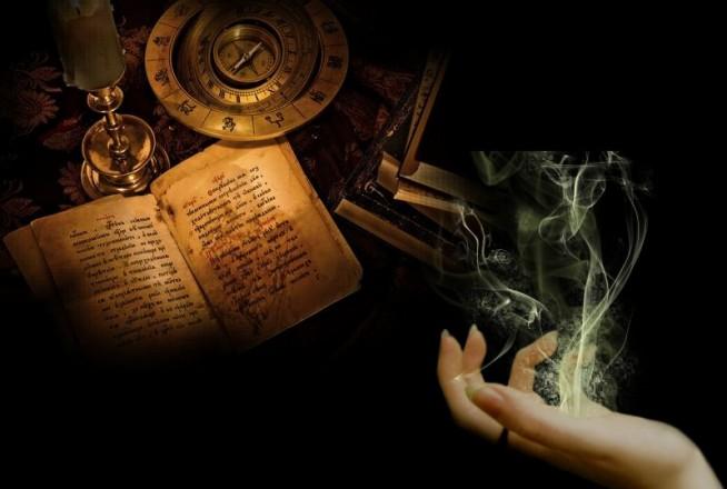 Старая книга и рука с дымом